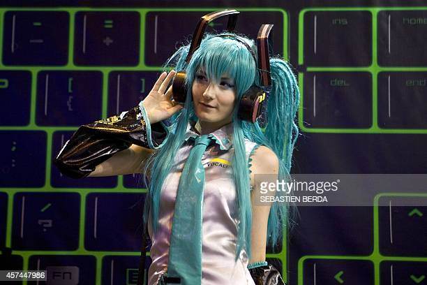 A cosplayer wearing a costume of famous Japanese virtual idol Miku Hatsune poses during the Madrid Games Week in Madrid on October 18 2014 The video...