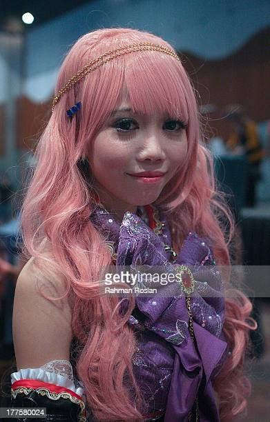 Cosplayer who dresses up as Japanese Manga character poses for a potrait during AniManGaki on August 24 2013 in Kuala Lumpur Malaysia Making its...