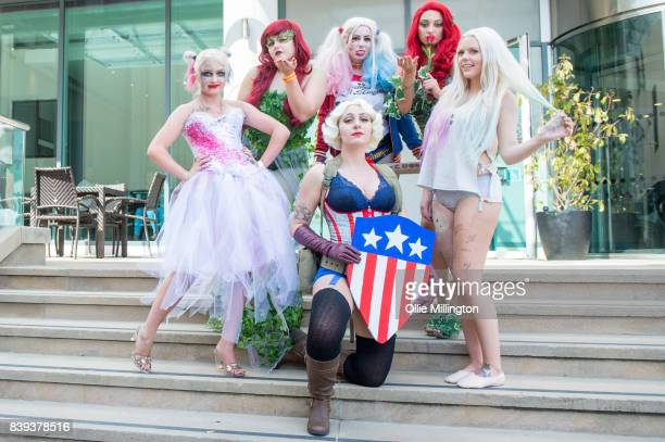 Cosplayers as Harley Quinn Poison Ivy and Captain America during Day 1 of the London Super Comic Con at Business Design Centre on August 25 2017 in...