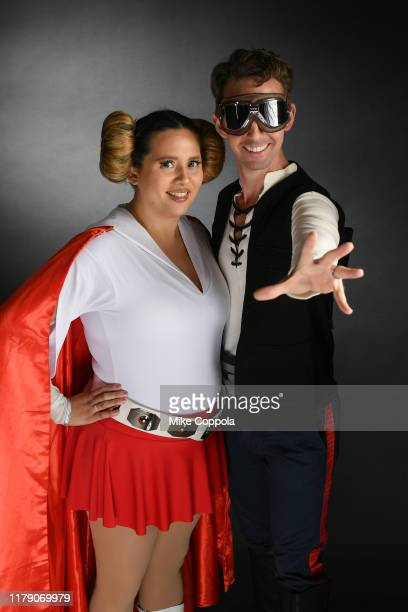 Cosplayers as Princess Leia and Han Solo pose with Starbucks cups during New York Comic Con at the Javits Center on October 04, 2019 in New York City.