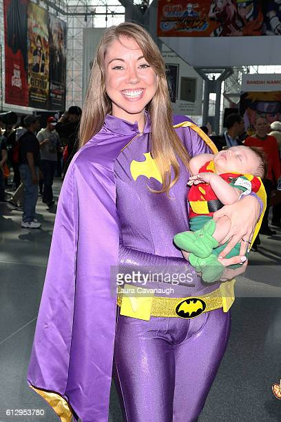 Cosplayers Ashley Greer and Grayson Greer dressed as Batgirl and Robin attend New York Comic Con Day 1 on October 6 2016 in New York City