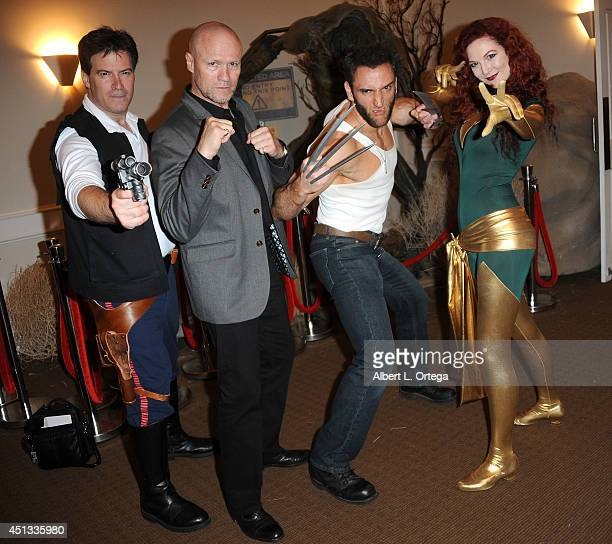 Cosplayers Brian Sikoff as Han Solo actor Michael Rooker Lon Brown as Wolverine Ashlynne Rae as Phoenix attend the After Party for the 40th Annual...