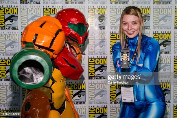 """Cosplayers Brianna MacNider and Lauren Busby dressed as two different versions of Samus Aran from the """"Metroid Prime"""" video game at 2019 Comic-Con..."""