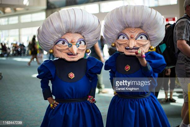 """Cosplayers Chieko as Zeniba and Chihiro as Yubaba from """"Spirit In The Wind"""" pose at 2019 Comic-Con International on July 21, 2019 in San Diego,..."""