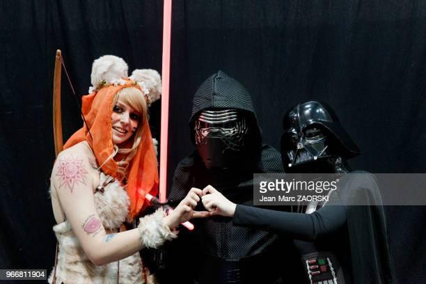 Cosplayers déguisés de gauche à droite en personnages de Star Wars un ewok Kylo Ren et Dark Vador lors de la Japan Expo Sud 7ème vague au Parc Chanot...