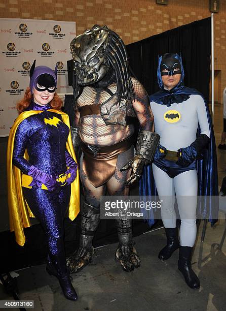 Cosplayers dressed as Batgirl The Predator and Batman attend Wizard World Philadelphia Comic Con 2014 held at Pennsylvania Convention Center on June...