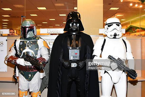Cosplayers dressed as Boba Fett Darth Vader and A Stormtrooper from Star Wars attend the Carrie Fisher book signing of her new book The Princess...