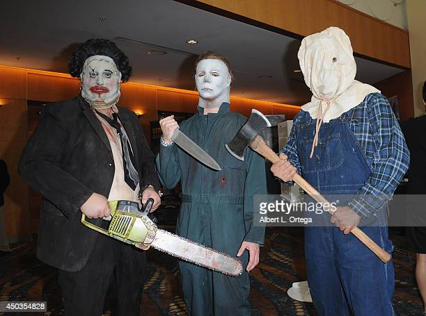Cosplayers dressed as Brothers of the Mask Leatherface Michael Myers and Jason Voorhees attend the 2014 Long Beach Comic Expo at the Long Beach...