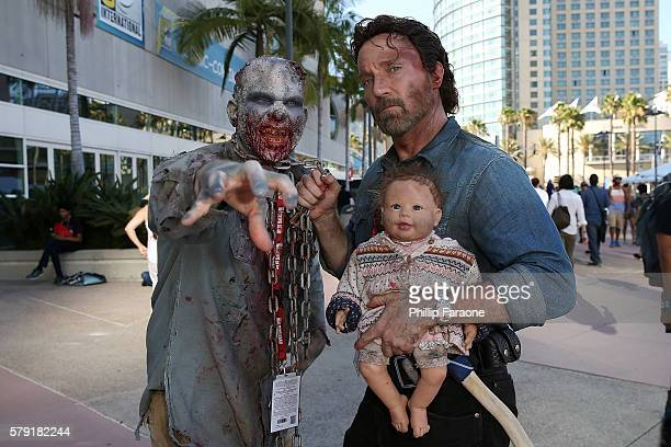 Cosplayers dressed as characters from 'The Walking Dead' attend ComicCon International 2016 on July 22 2016 in San Diego California
