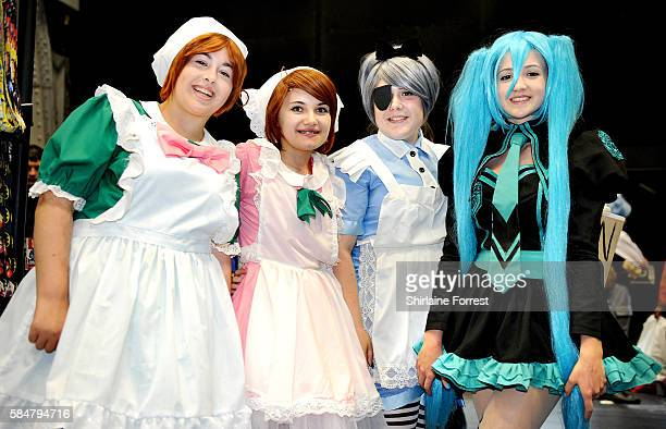 Cosplayers dressed as Chibi Romano and Chibitalia of Hetalia Black Butler of Ciel in Wonderland and Miku Hatsune a Vocaloid attend MCM Comic Con at...