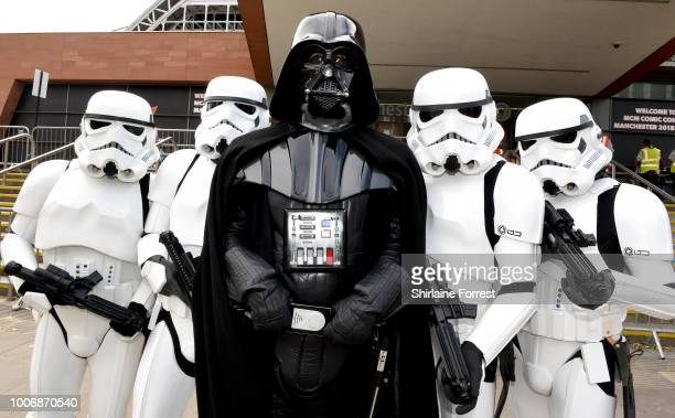 Cosplayers dressed as Darth Vader and Stormtroopers of Star Wars pose during MCM Comic Con 2018 at Manchester Central on July 28 2018 in Manchester...