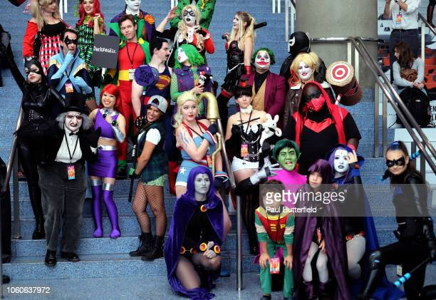 Cosplayers dressed as DC Comics characters pose for a photo during Los Angeles Comic Con at Los Angeles Convention Center on October 27 2018 in Los...