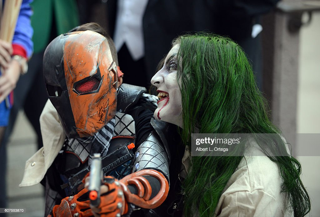 Cosplayers dressed as Deathstroke and The Joker attend the Long Beach Comic Con held at Long Beach Convention Center on September 17, 2016 in Long Beach, California.