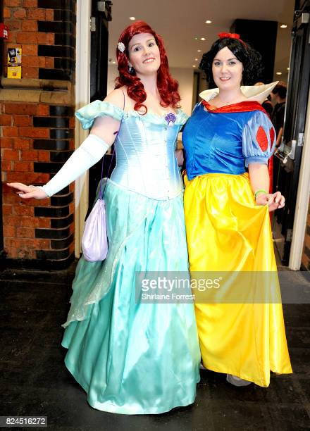 Cosplayers dressed as Disney's Princess Ariel and Snow White attend MCM Comic Con at Manchester Central on July 30 2017 in Manchester England