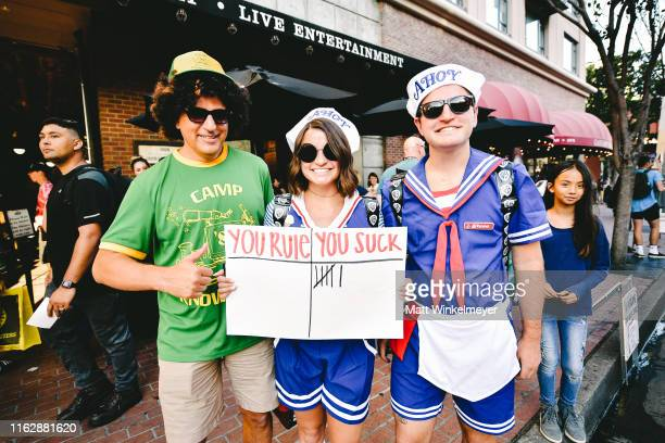 Cosplayers dressed as Dustin Henderson, Robin Buckley, and Steve Harrington attend the 2019 Comic-Con International on July 18, 2019 in San Diego,...