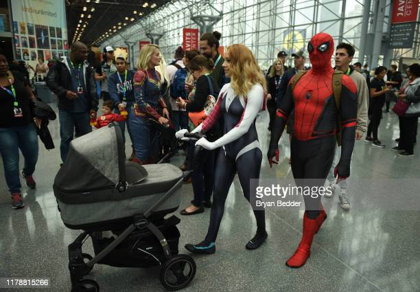 Cosplayers dressed as Gwen Stacy and SpiderMan attend the New York Comic Con at Jacob K Javits Convention Center on October 03 2019 in New York City