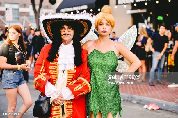 Cosplayers dressed as Hook and Tinkerbell attend the 2019 Comic-Con International on July 18, 2019 in San Diego, California.