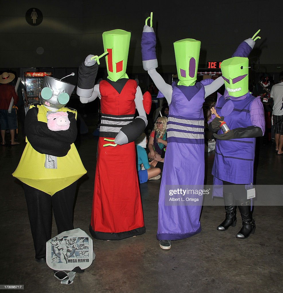 Cosplayers dressed as Invader Zim attend the Anime Expo (AX) 2013 held at The Los Angeles Convention Center on July 6, 2013 in Los Angeles, California.
