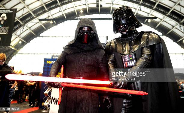 Cosplayers dressed as Kylo Ren and Darth Vader of Star Wars attend MCM Comic Con at Manchester Central on July 30 2017 in Manchester England