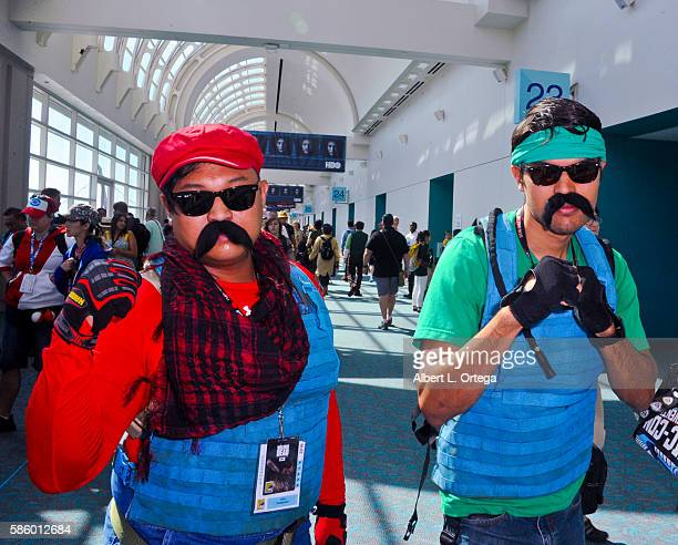 Cosplayers dressed as Mario and Luigi from 'Mario Bros' on day 3 attends ComicCon International 2016 at San Diego Convention Center on July 23 2016...