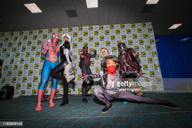 Cosplayers dressed as Marvel characters attend Comic-Con International on July 18, 2019 in San Diego, California.