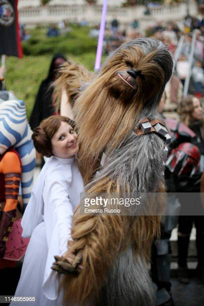 Cosplayers dressed as Princess Leila and Chewbacca attend a Flashmob during the Star Wars Day 2019 at Piazza di Spagna on May 04 2019 in Rome Italy