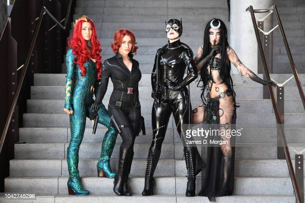 Cosplayers dressed as Queen Myra Black Widow Catwoman and Enchantress attend the Oz ComicCon Sydney at the International Convention Centre on...