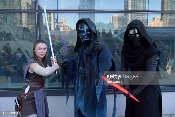 Cosplayers dressed as Rey Ghost of Darth Vader and Kylo Ren from Star Wars pose during New York Comic Con 2019 Day 3 at Jacob K Javits Convention...