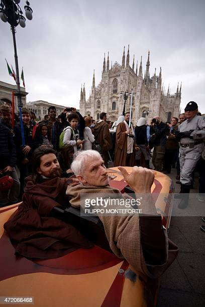 Cosplayers dressed as 'Star Wars' characters Obi Wan Kenobi and Anakin Skywalker pose near Milan's Duomo on May 3 2015 as part of Star Wars Day AFP...