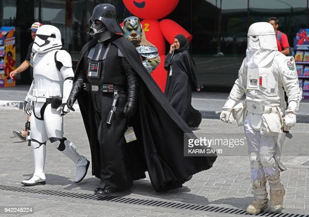 Cosplayers dressed as Star Wars Stormtrooper Snowtrooper Darth Vader and a Gamorrean attend the Middle East Film Comic Con on April 5 in Dubai / AFP...