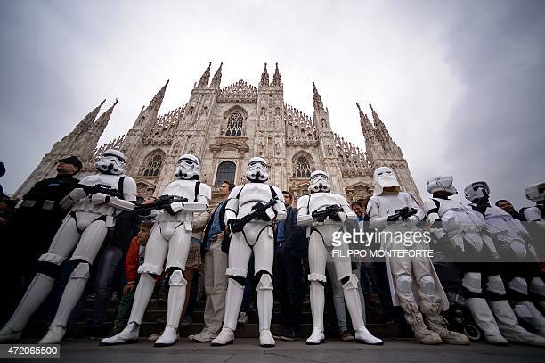 Cosplayers dressed as 'Star Wars' stormtroopers stand in front of Milan's Duomo on May 3 2015 as part of Star Wars Day AFP PHOTO / FILIPPO MONTEFORTE