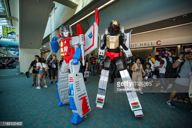 "Cosplayers dressed as Starscream and Grimlock from ""Transformers"" attend 2019 Comic-Con International on July 19, 2019 in San Diego, California."