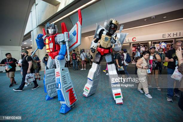 Cosplayers dressed as Starscream and Grimlock from Transformers attend 2019 ComicCon International on July 19 2019 in San Diego California