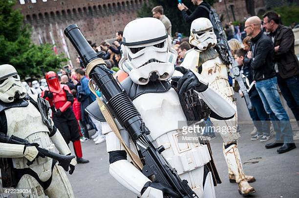Cosplayers dressed as Storm Troopers attend the Star Wars Day on May 3 2015 in Milan Italy