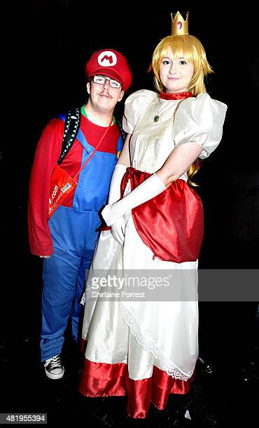 Cosplayers dressed as Super Mario and Princess Peach Toadstool attend Comicon at Manchester Central on July 25 2015 in Manchester England