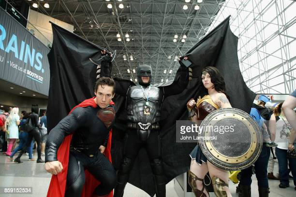 Cosplayers dressed as Superman Batman and Wonder Woman attend the 2017 New York Comic Con on October 8 2017 in New York City