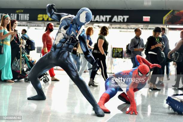 Cosplayers dressed as Symbiote SpiderMan and SpiderMan during New York Comic Con 2018 at Jacob K Javits Convention Center on October 4 2018 in New...