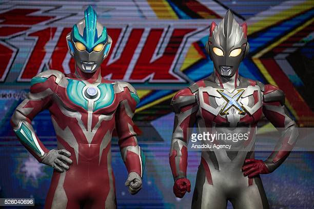 Cosplayers dressed as 'Ultraman' character from an old movie series in Japan created in 1966 pose for a picture during the Bangkok Comic Con 2016...