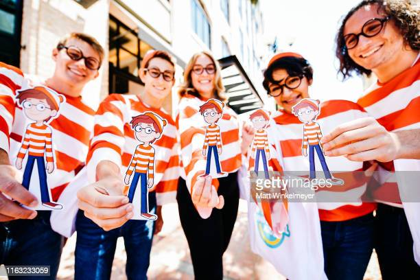 Cosplayers dressed as Waldo attend the 2019 Comic-Con International on July 20, 2019 in San Diego, California.
