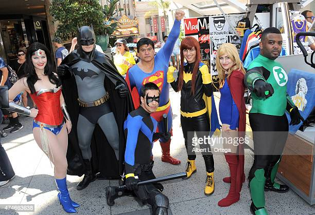 Cosplayers dressed as Wonder Woman Batman Superman Batgirl Supergirl Green Lantern and Nightwing at Warner Bros And DC Comics Super Hero World Record...