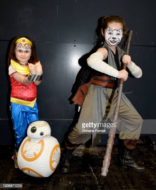 Cosplayers dressed as Wonderwoman and Rey of Star Wars pose during MCM Comic Con 2018 at Manchester Central on July 28 2018 in Manchester England