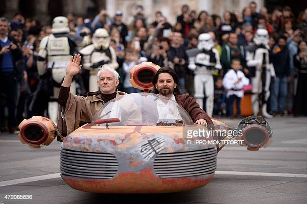 Cosplayers dressed 'Star Wars' characters Obi Wan Kenobi and Anakin Skywalker attend a Star Wars Day event in Milan on May 3 2015 AFP PHOTO / FILIPPO...