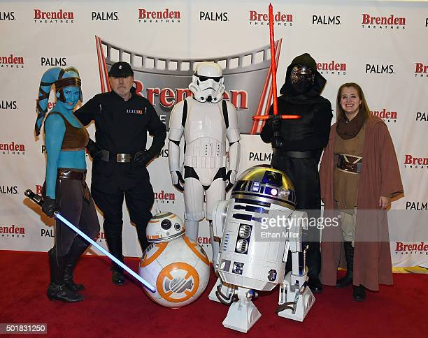 Cosplayers from The Twin Suns Star Wars Club Mary Nocie Bruce MacRae Mitchell Witherly Dan Glitch and Tiffany Dykstra pose with BB8 and R2D2 robots...