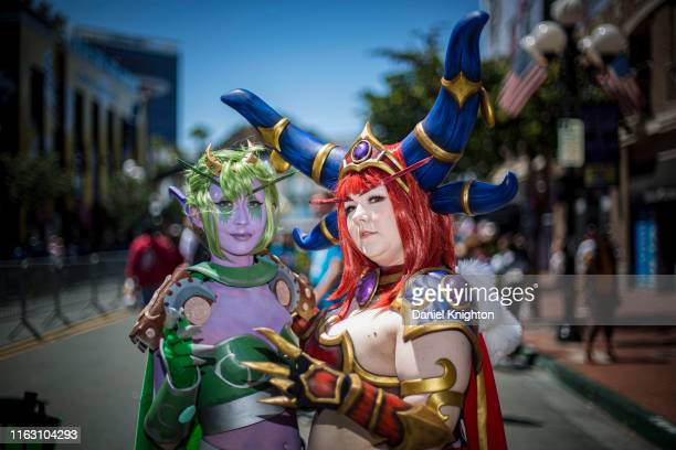 """Cosplayers Heather Fratt as Ysera and Emily Parker as Alexstraza from """"World of Warcraft at 2019 Comic-Con International on July 19, 2019 in San..."""