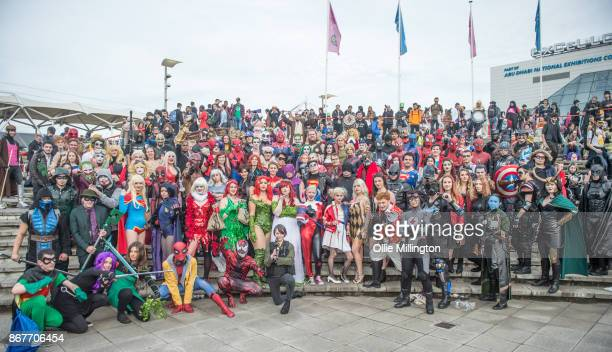 A Cosplayers in character as characters from Marvel and DC comics including Harley Quinn Batman Spiderman Superman Poison Iy Captain America Thor...