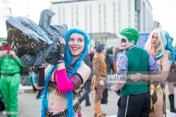 cosplayers in character as Jinx from Teen Titans nightlcub Harley Quinn and The Joker reinact the famous jelous boyfriend meme during MCM London...