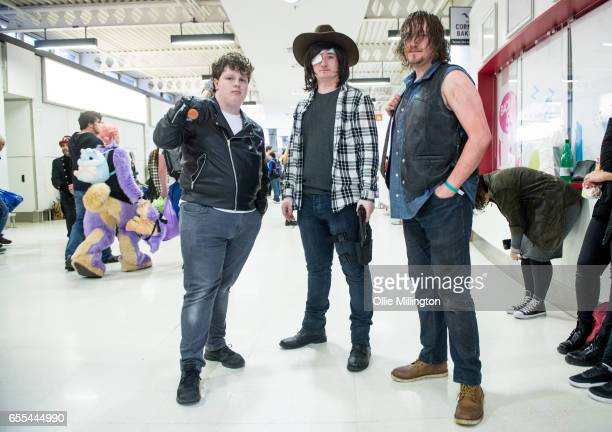 Cosplayers in character as Negan Carl and Daryl Dixon from The Walking Dead during the MCM Birmingham Comic Con at NEC Arena on March 19 2017 in...
