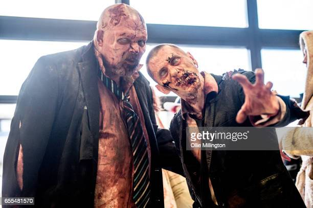 Cosplayers in character as office worker Zombies during the MCM Birmingham Comic Con at NEC Arena on March 19 2017 in Birmingham England