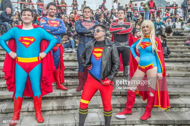 A Cosplayers in character as Superman and Superwoman during MCM London Comic Con 2017 held at the ExCel on October 28 2017 in London England