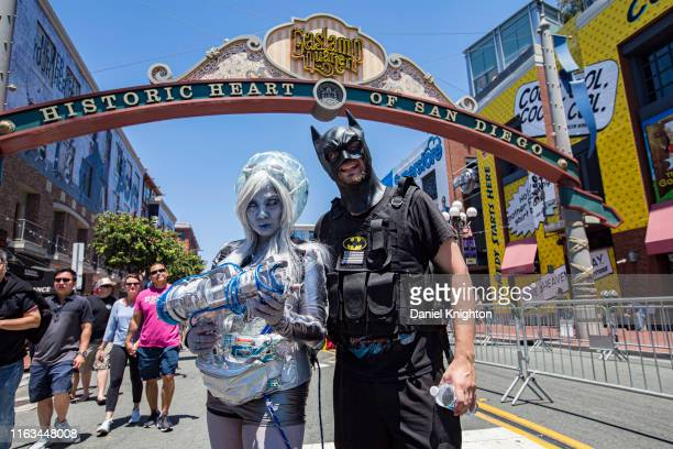 "Cosplayers Jasmine Honaker as Mrs. Freeze and Steve Welsh as Batman from ""Batman"" pose outside 2019 Comic-Con International on July 21, 2019 in San..."